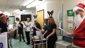 CF team with carols and presents